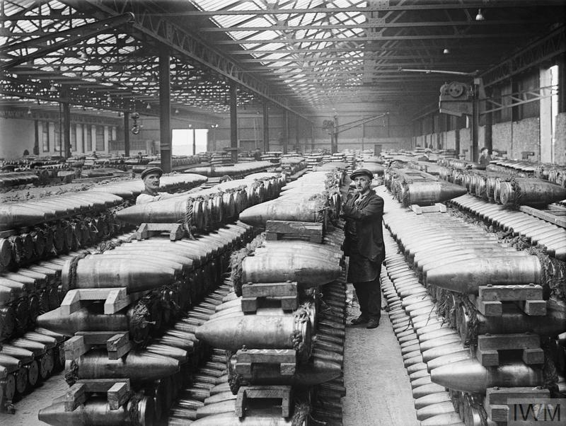 Colony of Belgian workers in Britain. The bond store at the National Projectile Factory, showing stacks of 8 inch shells. Birtley-Elisabethville, Co. Durham, 1918.