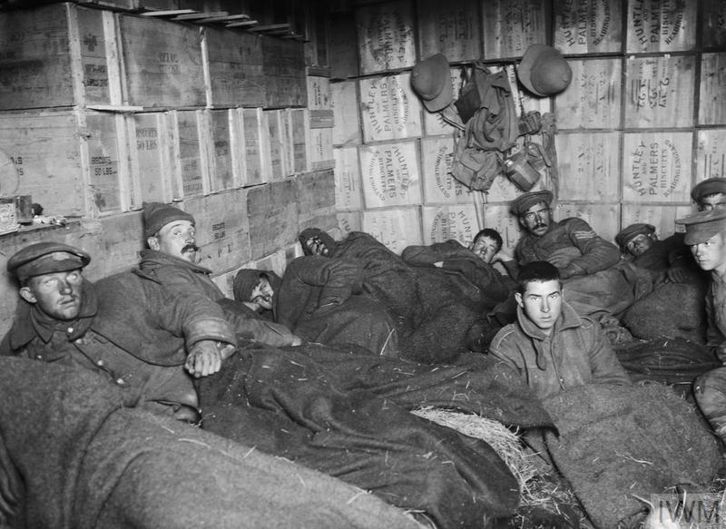 Frost-bitten soldiers lying in shelters constructed of biscuit boxes at a store dump at Suvla © IWM (Q 13644)