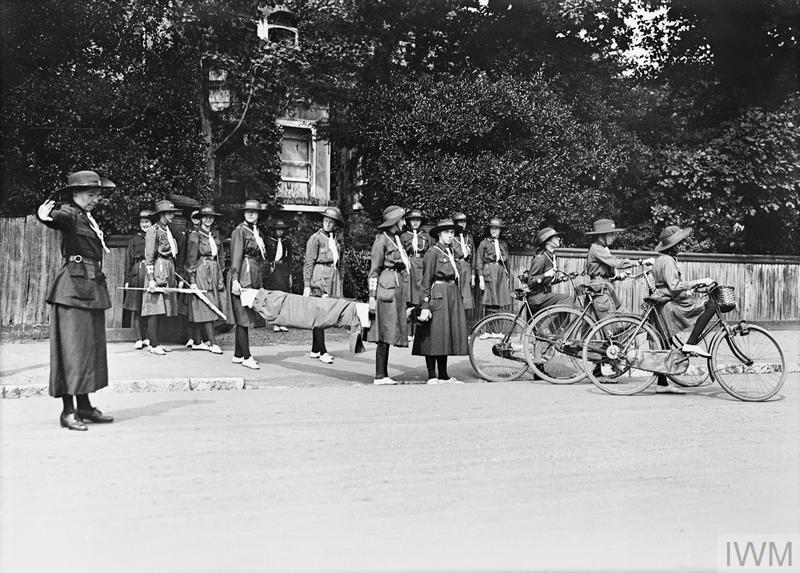 Girl Guides with a stretcher and other equipment in preparation to provide emergency help after an air raid.