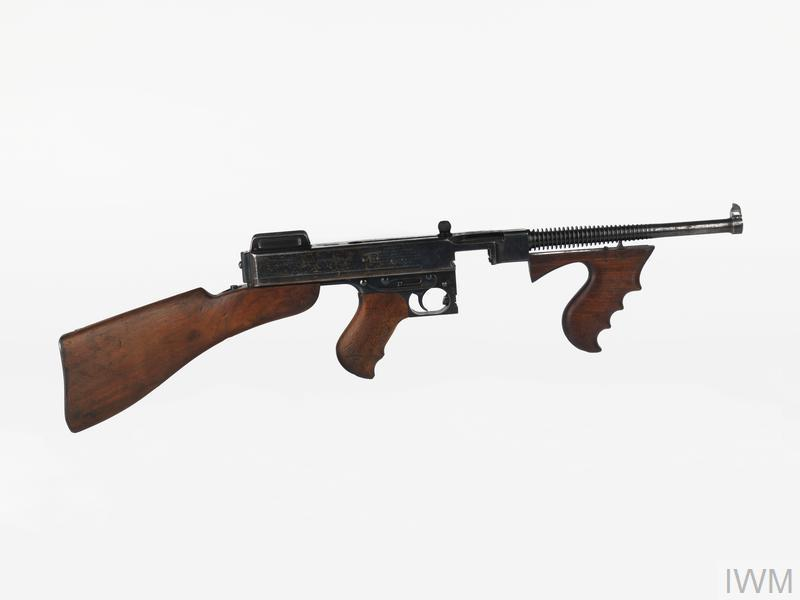 "The Thompson submachine-gun was developed as a result of efforts by a retired US General, John T Thompson, to produce a lightweight automatic rifle. Thompson wished to exploit a locking mechanism for firearms patented by John B Blish. This invention employed a sliding wedge in the bolt of the weapon to exploit the ""metallic adhesion"" of certain metals under high pressure, retarding the rearward motion of the bolt until pressure in the barrel had dropped to a safe level."