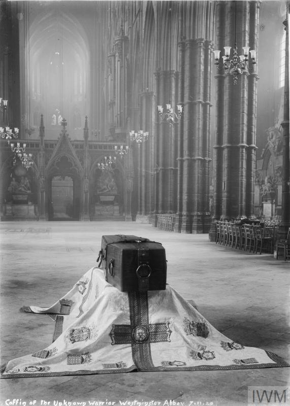 In order to commemorate the many soldiers with no known grave, it was decided to bury an 'Unknown Warrior' with all due ceremony in Westminster Abbey on 11th November, Armistice Day, in 1920. The photograph shows the coffin resting on a cloth in the nave of Westminster Abbey before the ceremony at the Cenotaph and its final burial.