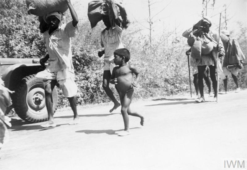 The Retreat into India: Burmese refugees flee along the Prome Road into India, January 1942.