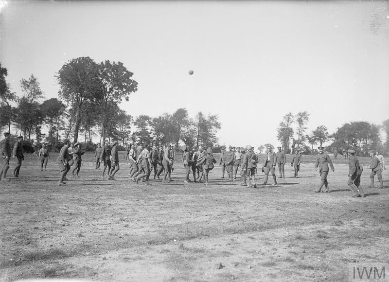 Troops of the 1st Battalion, Wiltshire Regiment, playing football near Bouzincourt, September 1916.