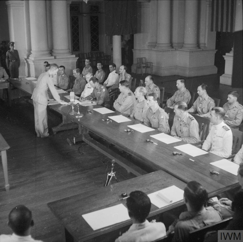 The Surrender Ceremony at Rangoon 28 August 1945.Lieutenant General F A M Browning, Chief of Staff to South East Asia Command signs the surrender agreement at Rangoon.