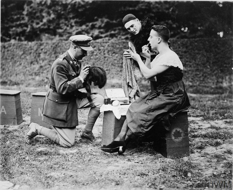 "Leisure and entertainment at the Front: A female impersonator of the ""Maple Leaves"", the Canadian Concert Party, making up for his role in a field on the Western Front. With women rarely permitted close to the front line, most concert parties had an actor who specialised in female roles."