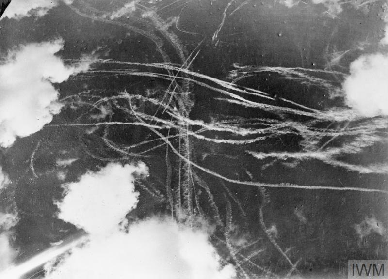 A pattern of contrails (or condensation trails) left by British and German aircraft high up in the sky, 18 September 1940.