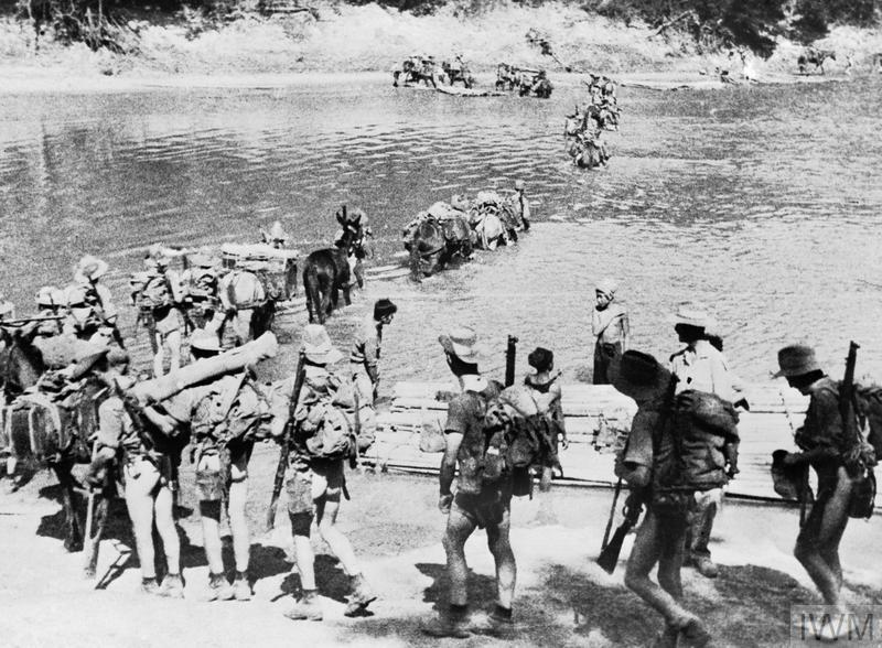 A Chindit column crossing a river in Burma, 1943.