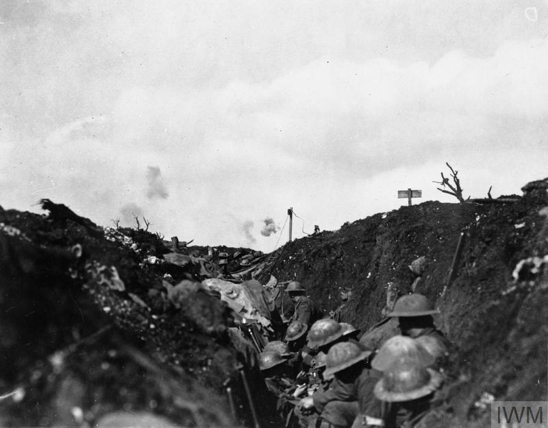 The Battle of Flers Courcelette 15 - 22 September: Shrapnel bursting over Canadian troops sheltering in a reserve trench.