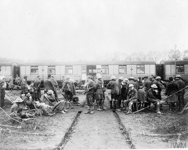Scene outside a Casualty Clearing Station (CCS) as casualties, including Canadians, wait to be loaded onto the Princess Christian Hospital train.