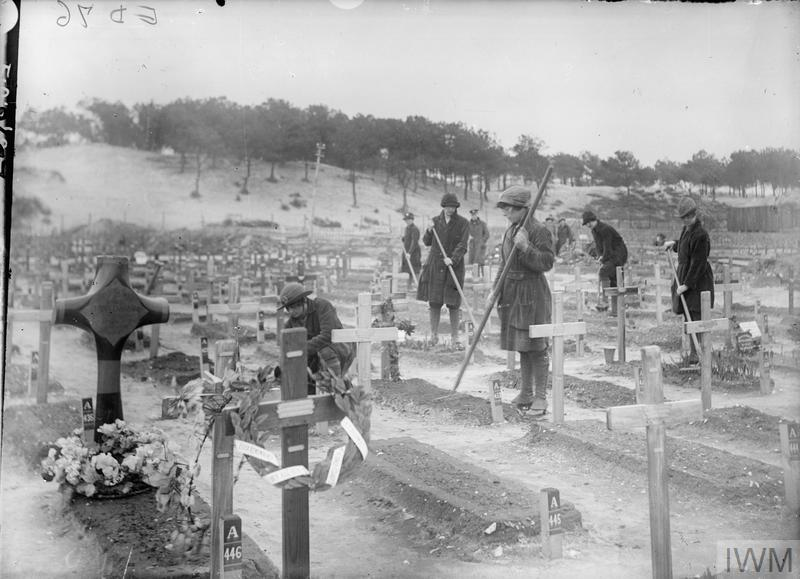 Women's Army Auxiliary Corps (WAAC) gardeners tending the graves of the war dead at Etaples. The wooden crosses would later be replaced by white headstones.