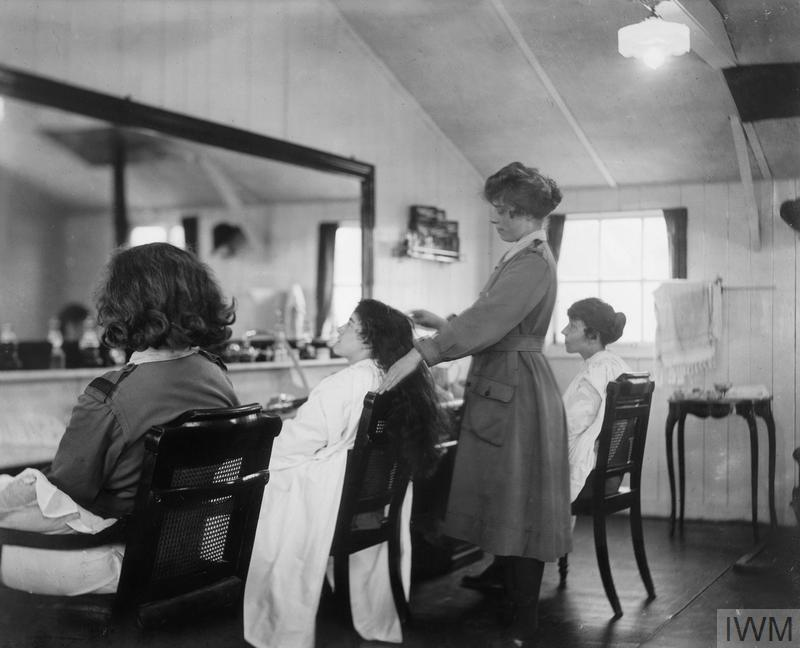 Women having their hair brushed in the hairdressers' shop for the Queen Mary's Army Auxiliary Corps (QMAAC) at Pont de l'Arche which enjoyed the reputation of being a regular Bond Street establishment.
