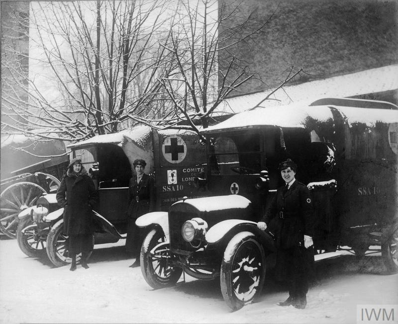 First Aid Nursing Yeomanry (FANY) drivers with their snow-covered motor ambulances at Commercy.