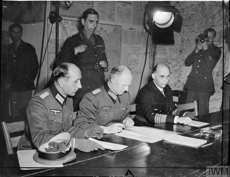 Generaloberst Alfred Jodl (1890 - 1946): Jodl signs the instrument of surrender at Rheims.