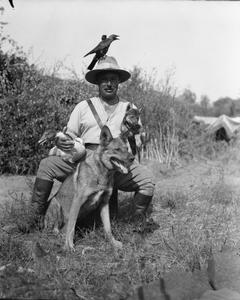 ANIMALS IN WAR 1914-1918: Pets and Mascots: A British officer of the Army Veterinary Corps in Salonika with his pets which included two jackdaws, a wild goose, a wolf cub and an Alsatian dog