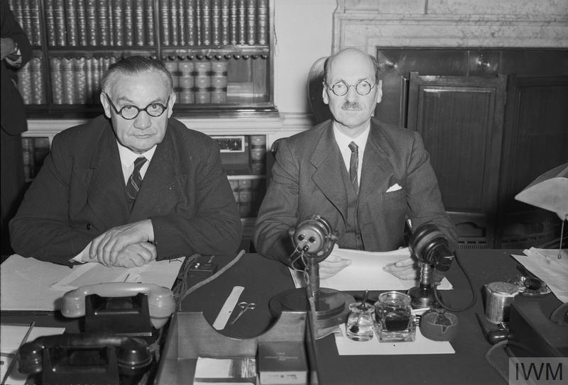 Prime Minister Clement Attlee (right) and Foreign Secretary Ernest Bevin at 10 Downing Street at midnight on 14 August 1945. They had just announced, in a speech broadcast to Britain and the Empire, the news of the Japanese surrender. © IWM H42138
