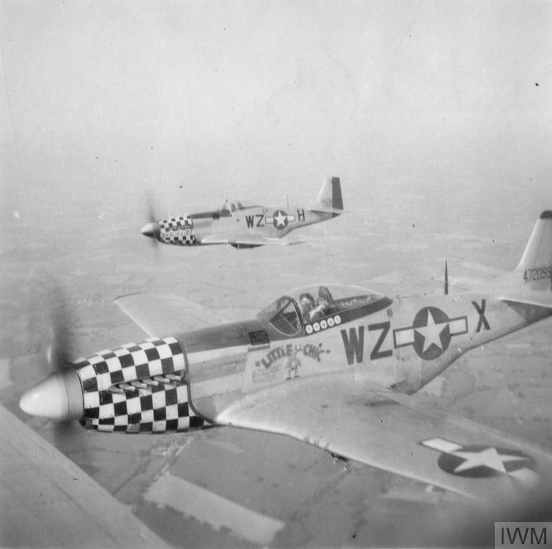 © IWM [FRE 265] - Two airborne P-51 Mustangs of the 84th Fighter Squadron, 78th Fighter Group.