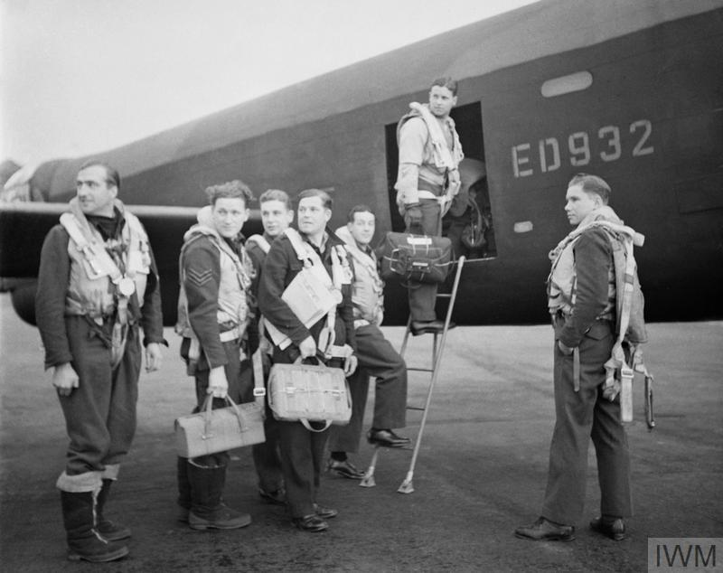 Personalities: Wing Commander Gibson and his crew board their Avro Lancaster A3-G (ED 932/G) for the Dams' raid. Left to right: Flight Lieutenant R D Trevor-Roper DEM; Sergeant J Pulford; Flight Sergeant G A Deering RCAF; Pilot Officer F M Spafford DFM RAAF; Flight Lieutenant R E G Hutchinson DFC; Wing Commander Guy Gibson; Pilot Officer H T Taerum RCAF.