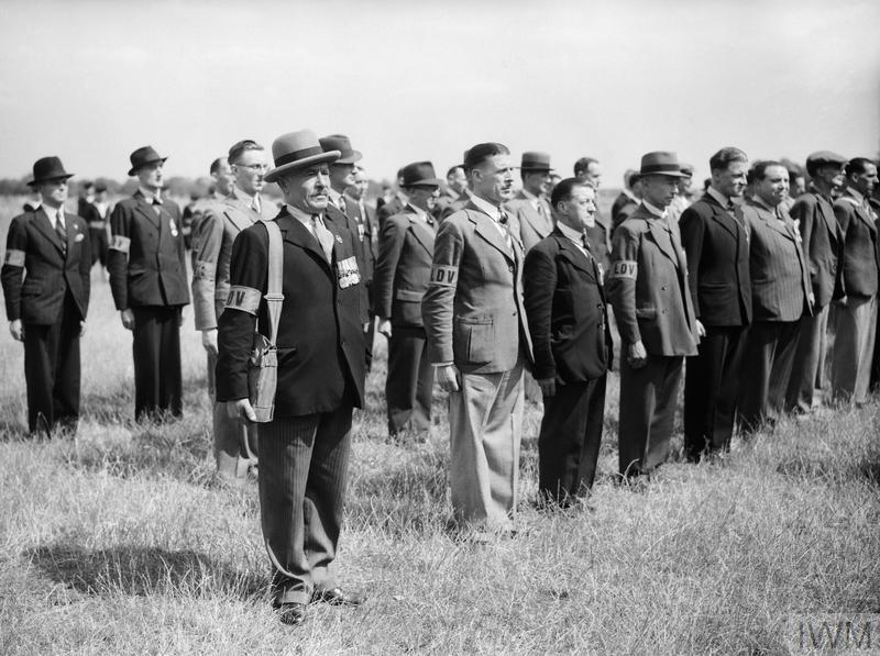 Local Defence Volunteers: 'Old Contemptibles' in the Local Defence Volunteers lined up for inspection. None of the men pictured wear any official uniform except for the LDV armband.