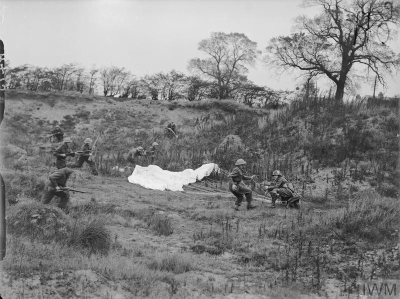 The Home Guard: Men of the 5th Battalion (Doncaster) Home Guard rounding up an 'enemy' parachutist during training for assisting the Army in the event of an invasion.