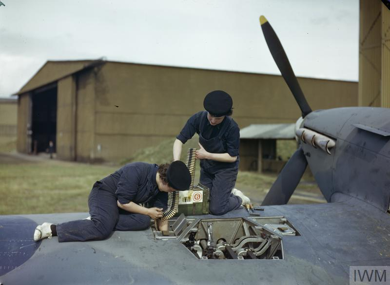 Armourers of the Women's Royal Naval Service (WRNS) re-arm a Hawker Hurricane aircraft.