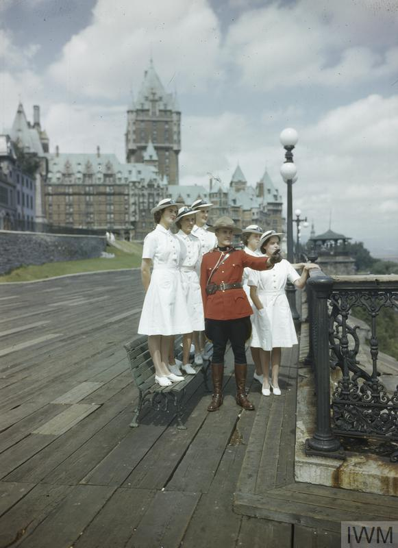 Women's Royal Naval Service: WRNS officers being shown the sights of Quebec by a member of the Canadian Mounted Police Force after the first Quebec Conference.