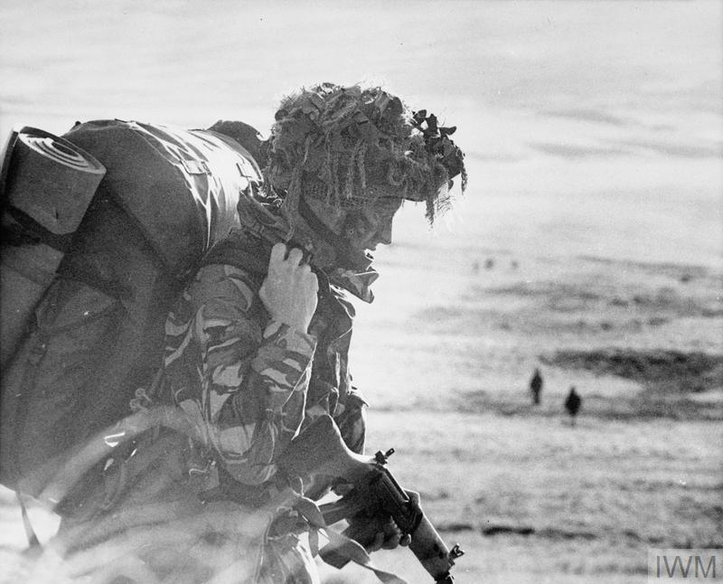 After landing at San Carlos, a heavily laden paratrooper of 2 Parachute Regiment heads south for Sussex Mountain on 21 May 1982. From there the Battalion attacked Goose Green.