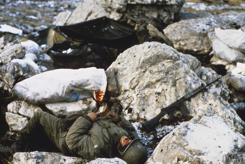 A dead Argentine soldier, possibly of Regimento de Infanteria 4 (4th Infantry Regiment), on Mount Harriet, near Port Stanley. B and C Companies of this regiment defended Mount Harriet on the night of 11 - 12 June 1982 and suffered 23 casualties.