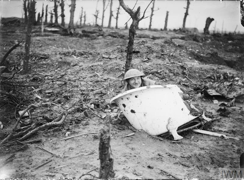 Humoresque photograph of a soldier resting in an old bath, near Maurepas.