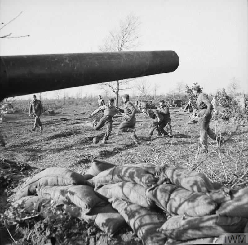 Gunners of 111 Medium Battery, 80th (Scottish Horse) Medium Regiment, Royal Artillery, playing a game of football near their guns in the Anzio area, Italy.