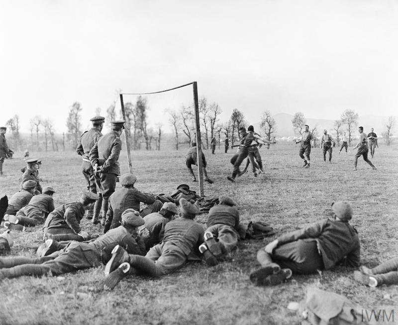 A photograph of an officers versus other ranks football match being played by members of the 26th Divisional Ammunition Train.
