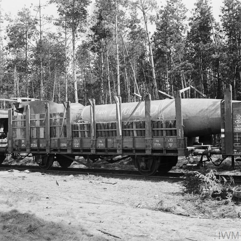Victory in the West April - May 1945: A V2 rocket loaded on a railway truck at Leese in Germany ready for transporting to the launch site. During their advance into Holland, the British and Canadians uncovered a number of V2 sites.