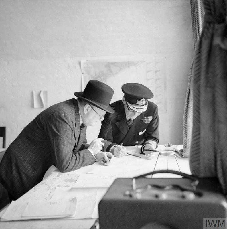 The Prime Minister Winston Churchill studies reports of the action that day with Vice Admiral Sir Bertram Ramsay, Flag Officer Commanding Dover, on 28 August 1940.