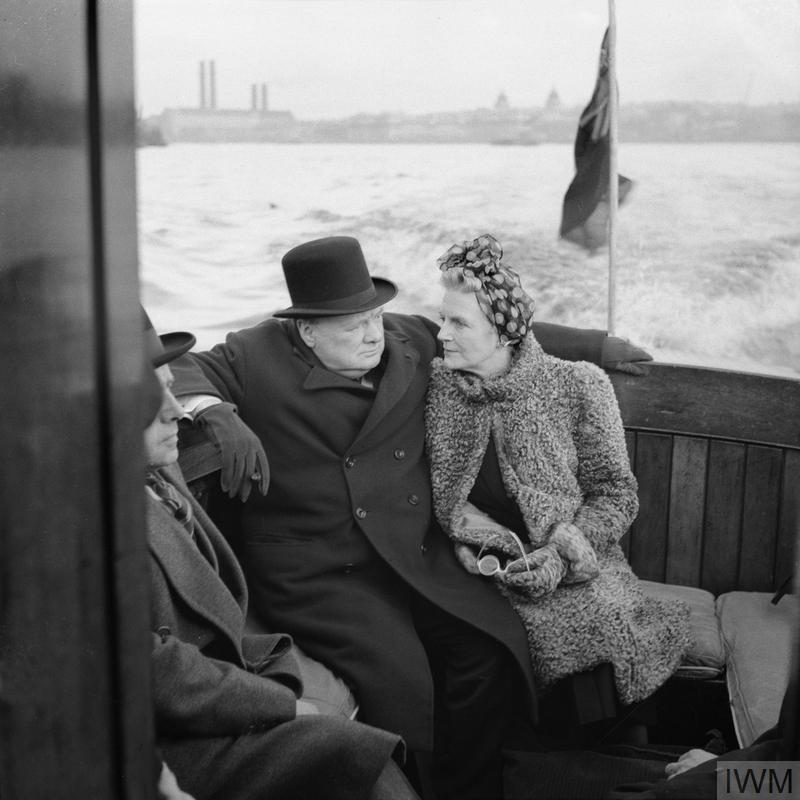 The Prime Minister Winston Churchill and his wife, Clementine, sit on board a naval auxiliary patrol vessel as it travels down the Thames towards docks in east London on 25 September 1940.