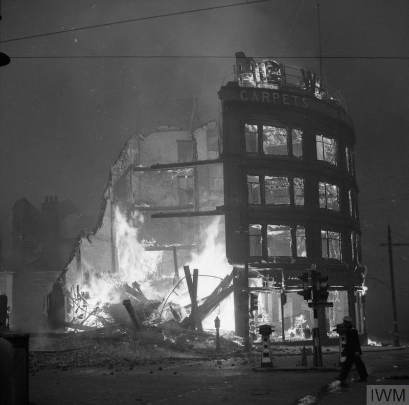 Buildings burning in Manchester after a German air raid on the night of 23 December 1940