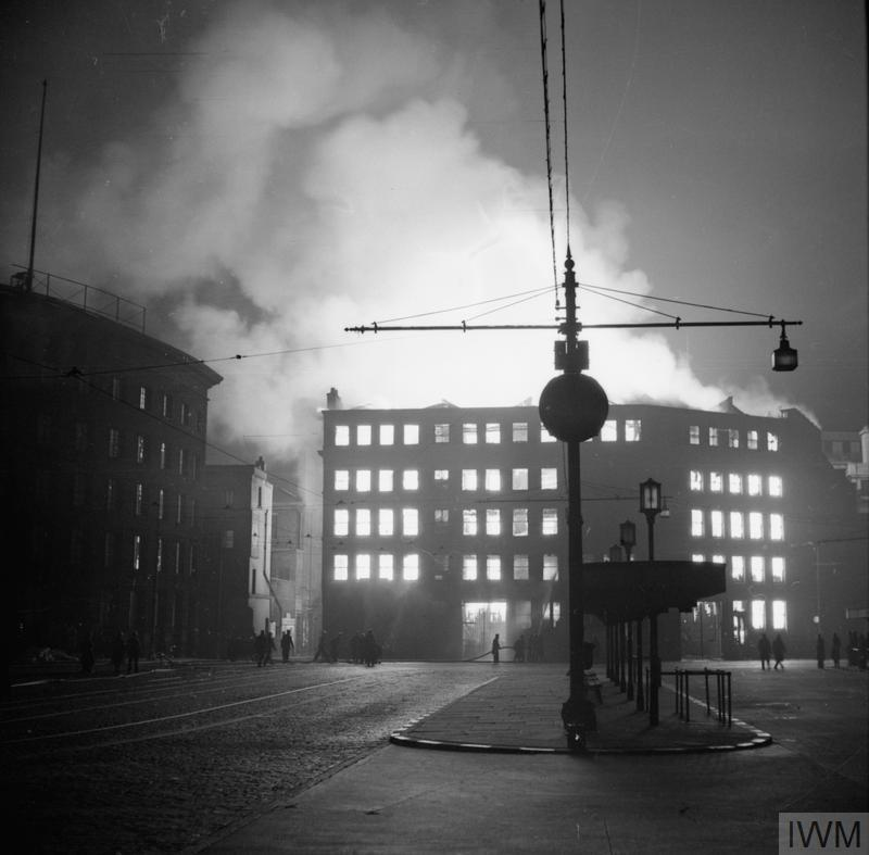 Buildings surrounding a bus station in Manchester burning after a German air raid on the night of 23 December 1940.