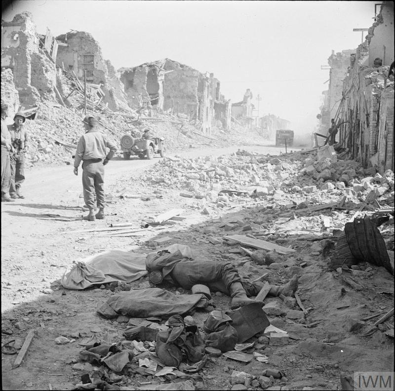 The ruins of Cisterna, which US Rangers made a disastrous attempt to capture on 30 January (6 out of 767 men returned), photographed after its final capture by the Americans. A dead German lies in the foreground.