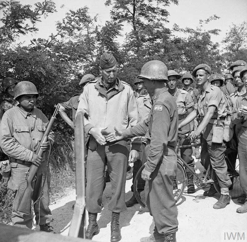 Personalities: The Commander of the US 5th Army, General Mark Clark with Allied troops from Anzio and the Gustav Line at the link-up point.