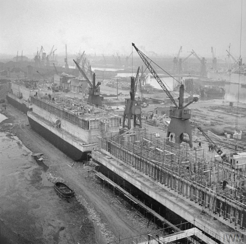 'Phoenix' concrete caissons, part of the Mulberry artificial harbour, being constructed in Surrey Docks in Rotherhithe, London, 17 April 1944.