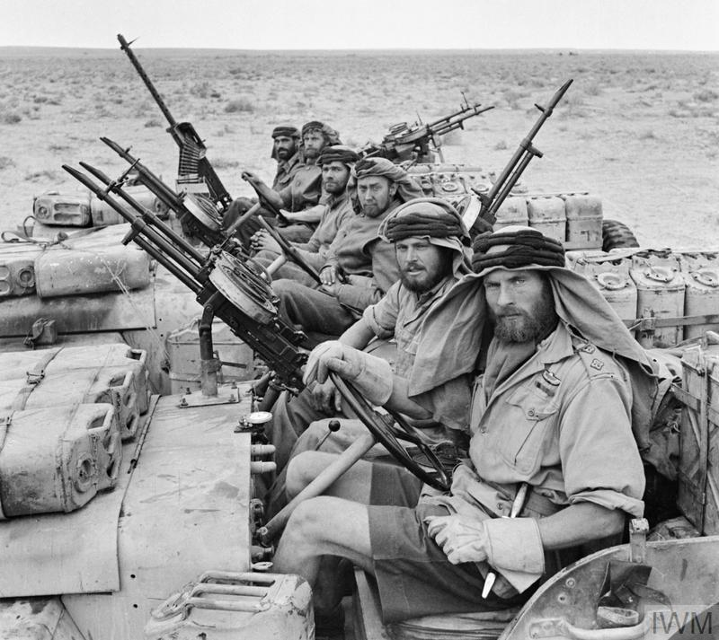 A heavily-armed patrol of 'L' Detachment SAS in their jeeps, wearing 'Arab-style' headdress, January 1943.