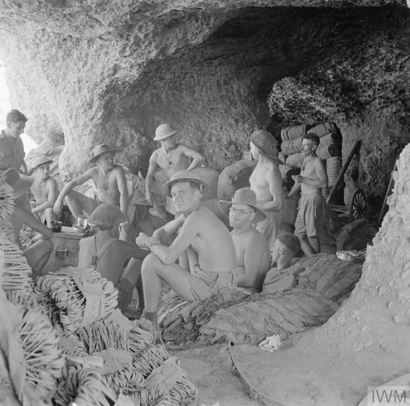 The 'Rats of Tobruk' - some of the 15,000 men of General Morshead's 9th Australian Division shelter in caves during an air raid during the siege of Tobruk. After six months besieged in the vital supply port the Australians were evacuated by sea and relieved by fresh troops. 823 men had been killed, 2214 wounded and 700 captured.
