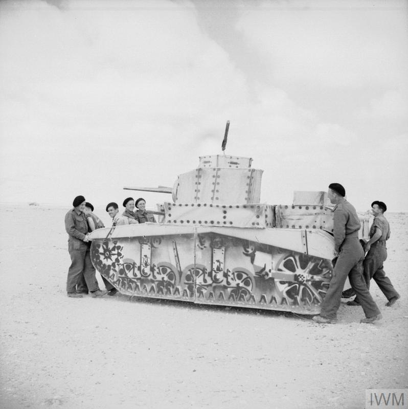 Troops carrying a dummy Stuart tank, 3 April 1942.