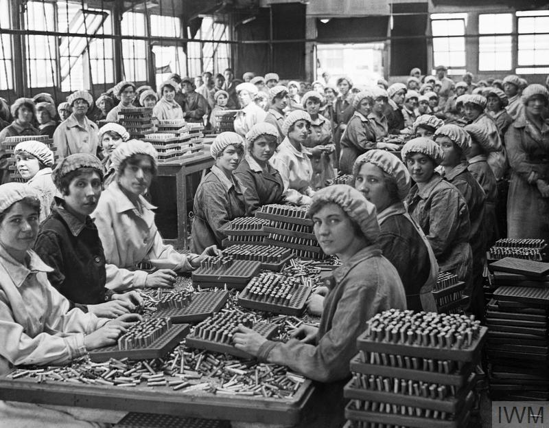 Women munition workers finish small arms cartridges in Small Arms Cartridge Factory 3, at Woolwich Arsenal, London, May 1918.