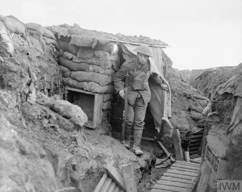 A sniper of the 6th Battalion. the York and Lancaster Regiment comes out of his post in a front line trench at Cambrin, 6th February, 1918.