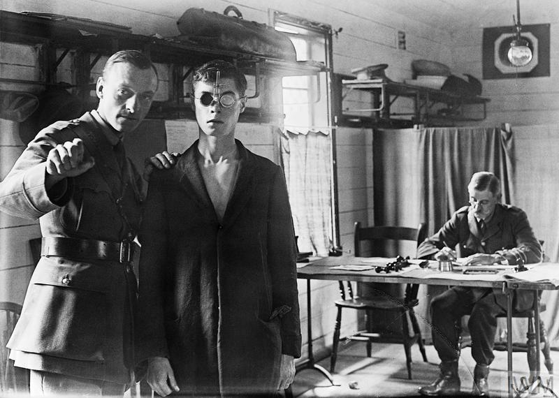 A recruit having an eye test on enlistment. Taken at Treaty Lodge, Hounslow, the HQ of the 8th Battalion, Middlesex Regiment, in September 1917.