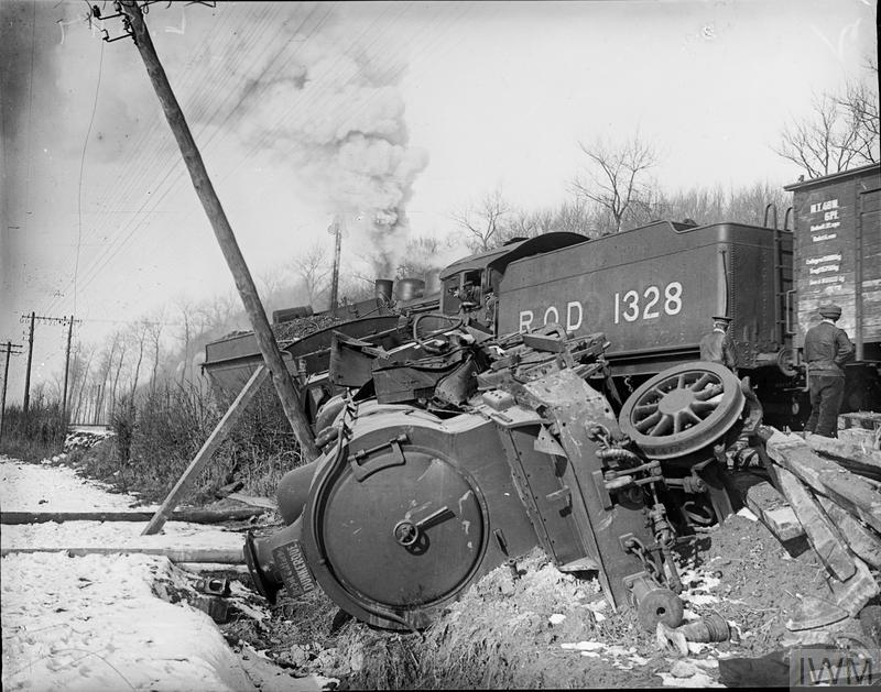 A derailed and overturned British railway engine in France. The overturned engine is ROD 1859 of the Depot D'attache Dunkerque. ROD 1328 can be seen on the tracks in the background. The initials ROD stand for the Railway Operating Division of the Royal Engineers who were responsible for the operation of military trains.