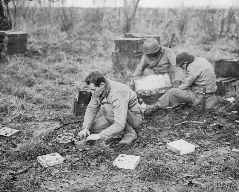 Men of the 28th Division HQ Company prepare mines to check the advancing German Panzers.