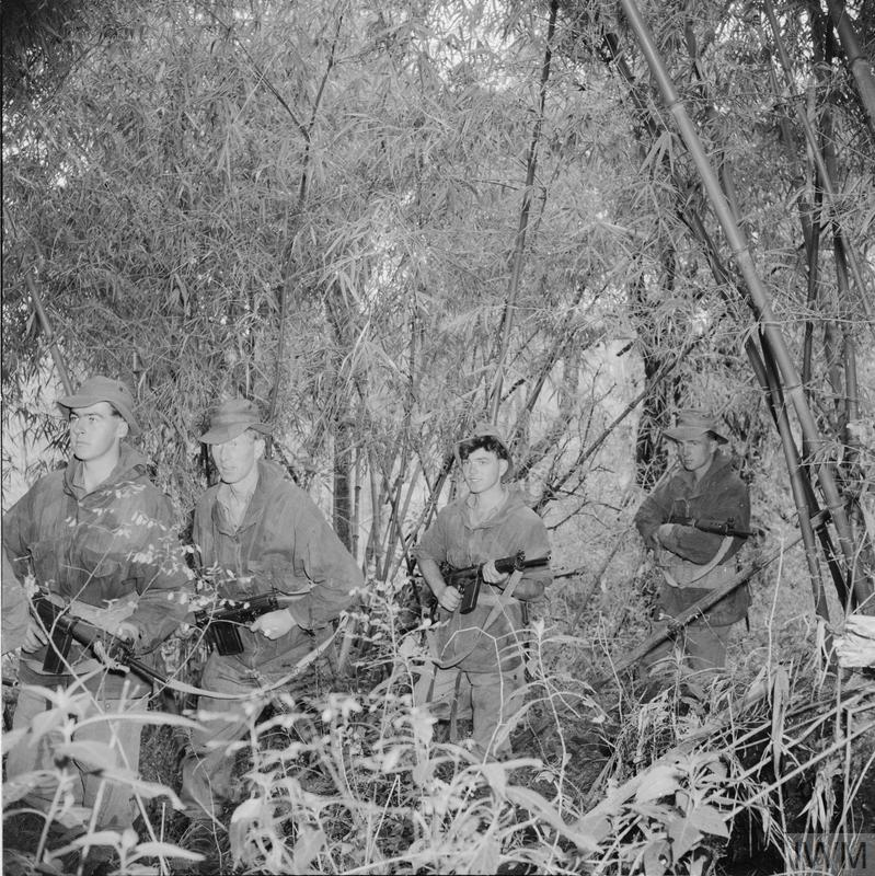 British Army soldiers in the jungle in Kenya during the Mau Mau uprising in 1952 or 1953.