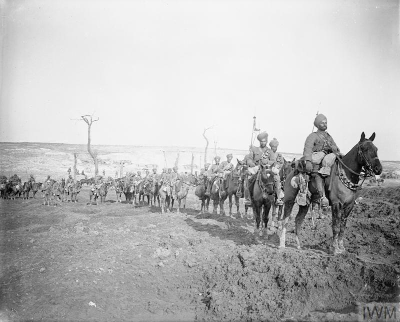 Troops of the 29th Lancers Regiment (Deccan Horse) near Pys, armed with lances and making their way through a shell torn landscape, March 1917.