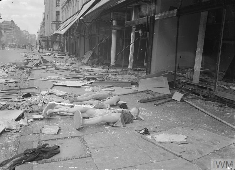 Shop mannequins are among the debris that litters the pavement outside the John Lewis department store on London's Oxford Street, following an air raid on London. Windows have been blown out and awnings damaged.