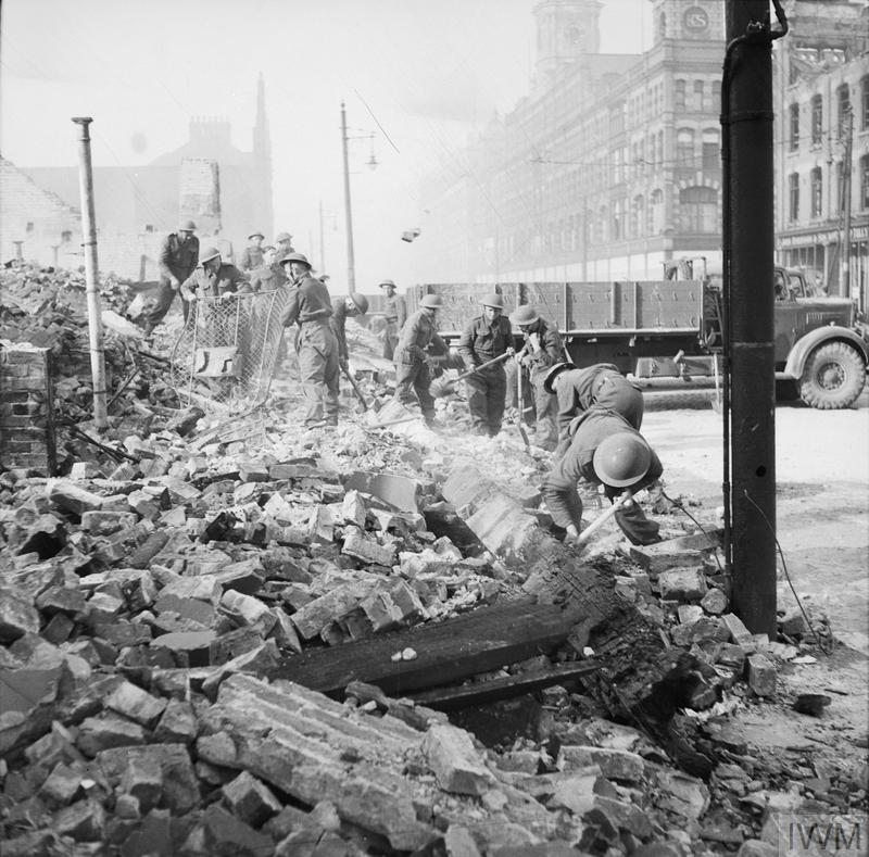 Royal Welch Fusiliers assist in clearing bomb damage in Belfast, Northern Ireland, 7 May 1941.
